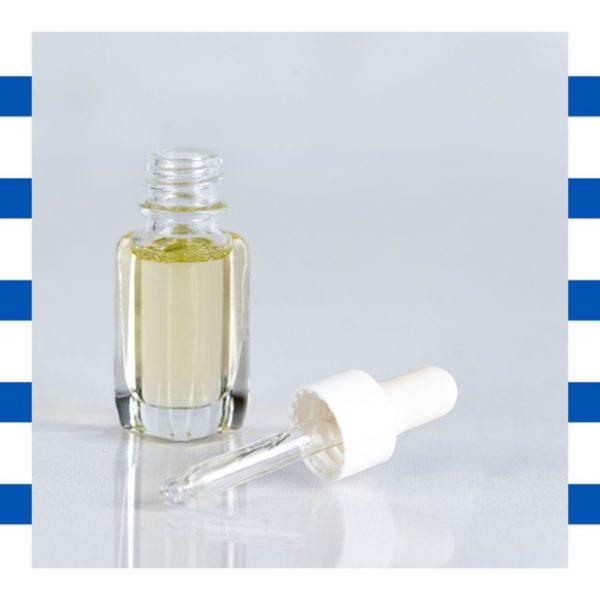photo de l'huile nourrissante ouverte pour voir la pipette en verre.